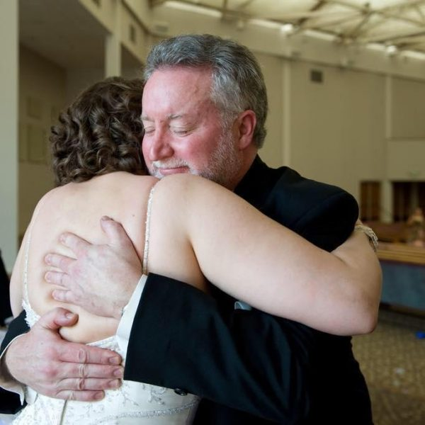 Rick hugging Karyn on her wedding day