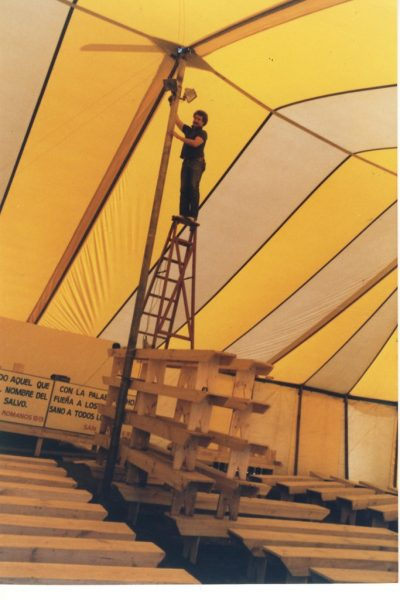 Dad installing lights for their tent crusade.