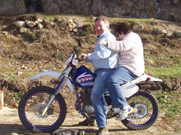 Dad convinced mom to get on his rather small dirtbike while we were at the beach.